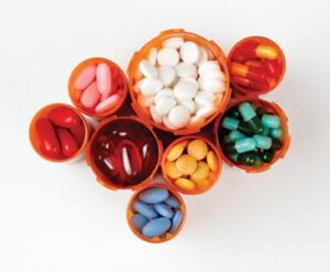 Prescription bottles filled with colorful medications