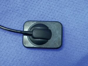 "FIGURE 3. Size 2 digital sensor for direct digital radiography; this ""back side"" of the sensor should be positioned away from the tube head."