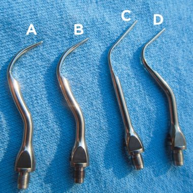 Figure 1. Ultrasonic scaler tips. Supragingival tips (A and B) are shorter and thicker than subgingival tips (C and D). The subgingival tips are designed to be used on lower power settings because they are used on cementum-covered roots as opposed to more robust enamel-covered crowns. Their design also allows coolant to reach the end of the instrument, thereby avoiding overheating of the teeth and associated soft tissue.