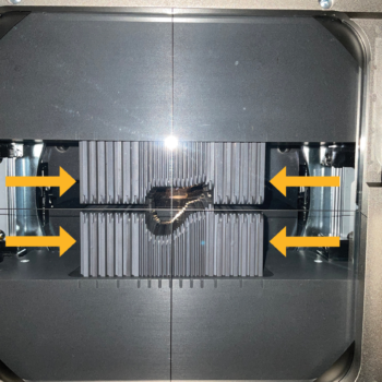 Figure 2. (B) The multileaf collimator (yellow arrows) positioned to shape the beam for a feline urinary bladder. The leaves on this machine are 2.5 mm in width at the center and 5 mm in width on the outer boundaries of the multileaf collimator.